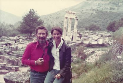 man and woman in front of Greek ruins