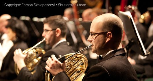 French horn players in an orchestra