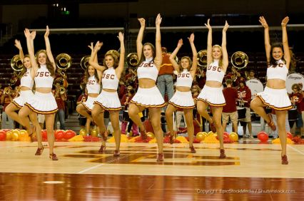 cheerleading squad preforming on basketball court