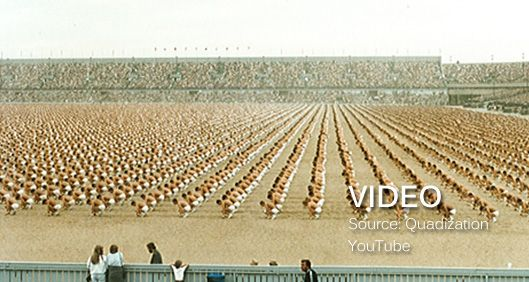 rows of dancers in a stadium