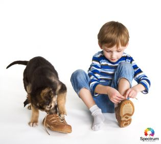 child tying shoes