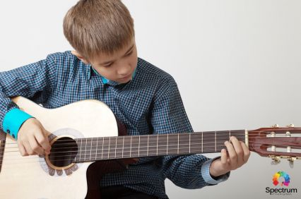 child playing the guitar