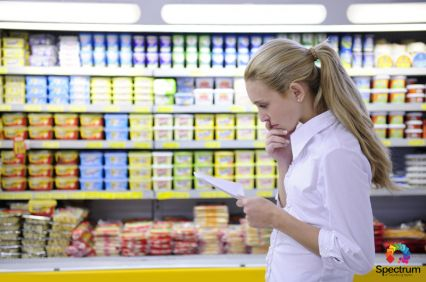 woman going over list in grocery store