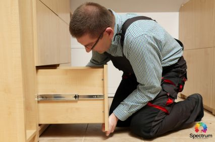technician working on drawer
