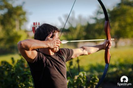 male shooting bow and arrow