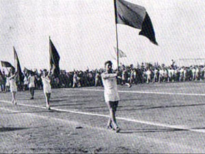 black and white image of men carrying flags