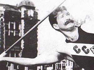 black and white image of a man throwing a javelin